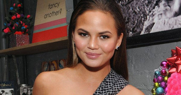 chrissy teigen lord and taylor with buffalo david bitten