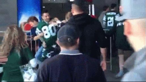 falcons jets fan punches woman in head nfl images