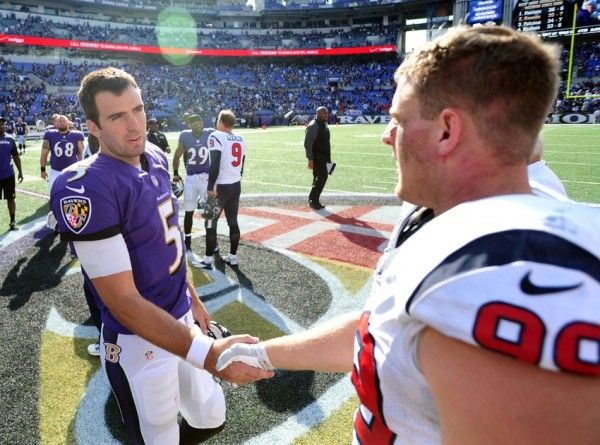 ravens joe flacco bulges up with jj watt houston texans 2014 nfl season images