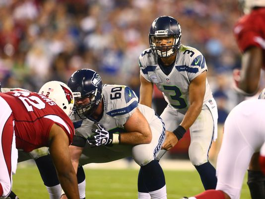 seattle seahawks russell wilson takes on cardinals defense nfl 2014 images