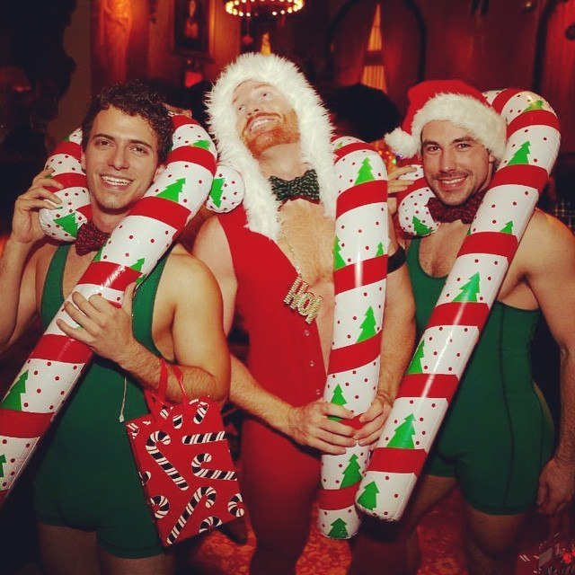 Sexy men dressed as santa