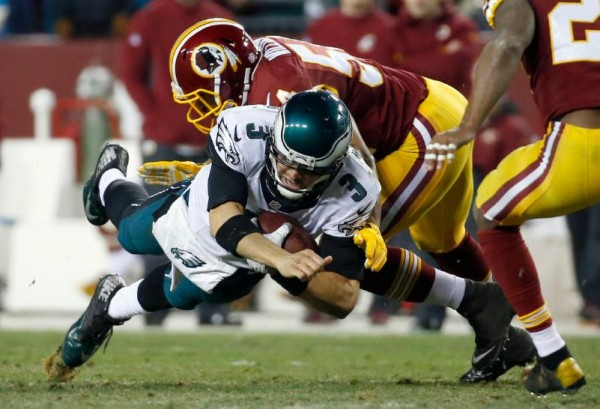 philadelphia eagles mark sanchez bulge down by trevardo williams redskins nfl 2014 images