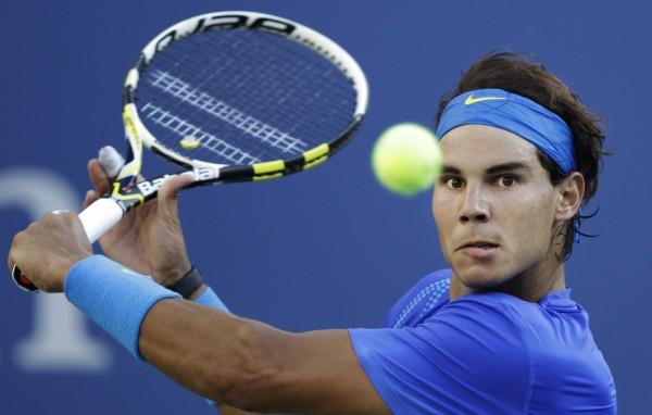 rafael nadal hitting balls hard for 2015 tennis atp images