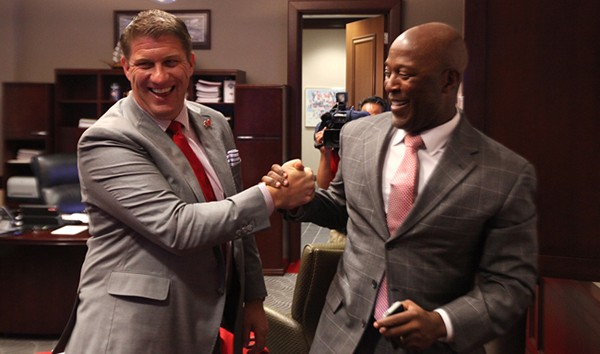 jason licht grips hands with coach lovie smith for tampa bay buccaneers 2015
