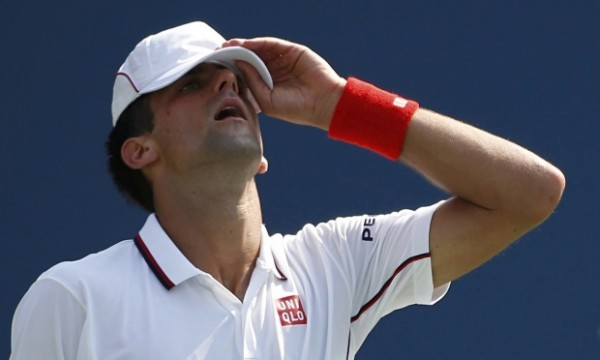 novak djokovic reacts to losing for kei nishikori 2014 tennis