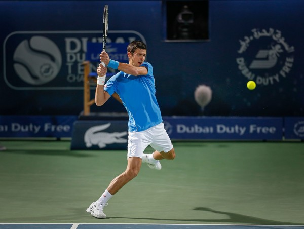 novak djokovic takes out borna coric atp dubai tennis 2015 images