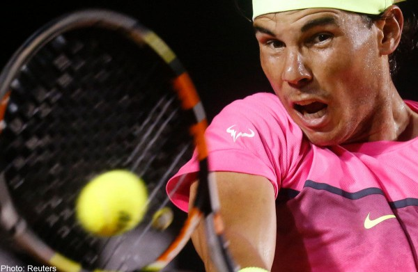 rafael nadal hitting hard for fabio fognini rio open 2015