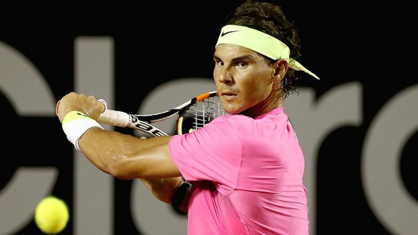 rafael nadal hitting tennis ball back to pablo cuevas rio open