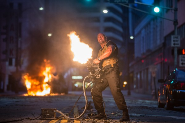dwayne johnson pulling bulge on furious 7 mini gun 2015 images