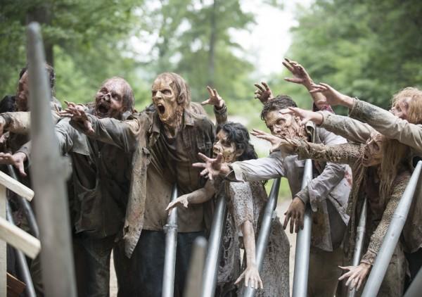 walking dead zombie walkers attacking gabriels church