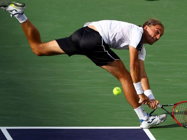 Alexandr Dolgopolov taking on novak djokovic balls for 2015 miami open masters