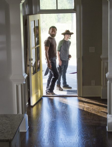 carl and rick grims look into new house walking dead 2015 images