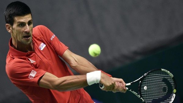 novak djokovic moves forward in davis cup 2015