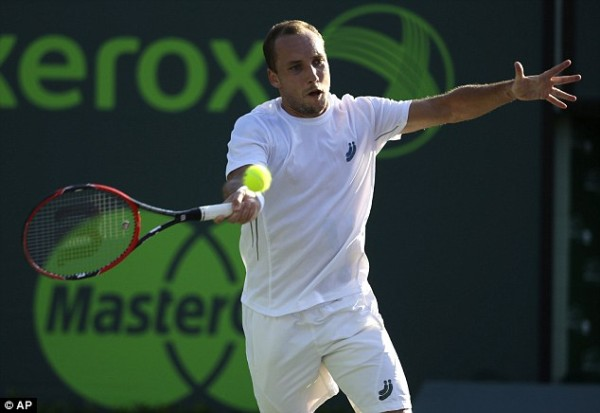 steve darcis tries to feel novak djokovics balls stroke at 2015 miami open masters