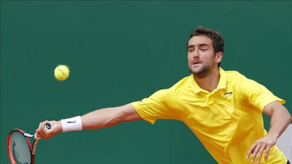 marin cilic tries to return novak djokovic serve monte carlo masters 2015