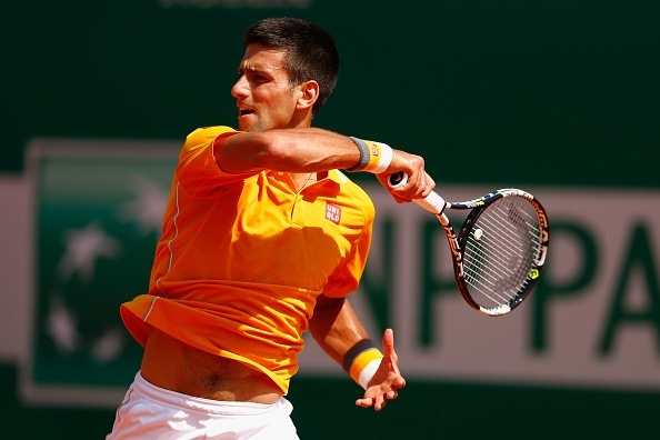 novak djokovic returns ball to andreas haider maurer for monte carlo masters win 2015