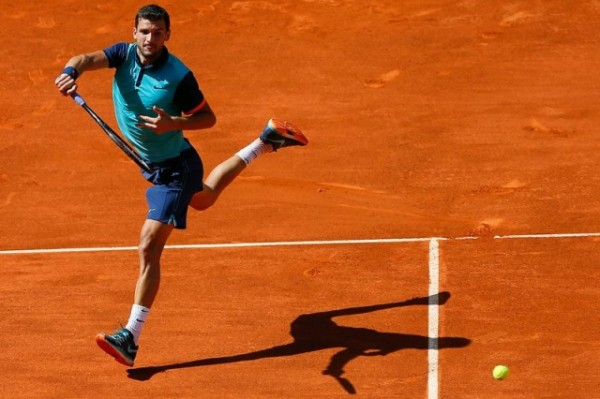 grigor dimitrov jumps for 2015 rome masters open win