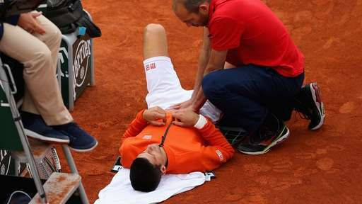 novak djokovic gets his groin worked on by medics at french open 2015