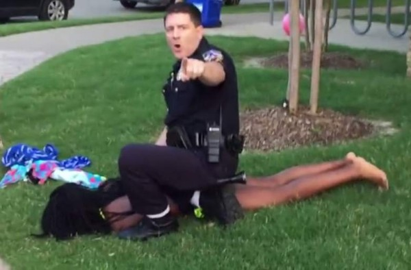 cops holding down black girl from pool party texas 2015