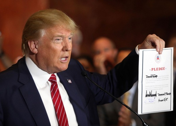 donald trump signs over future to republican loyalty pledge 2015 gossip