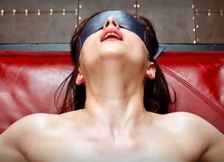 fifty shades of grey dakota johnson blindfolded images 2014