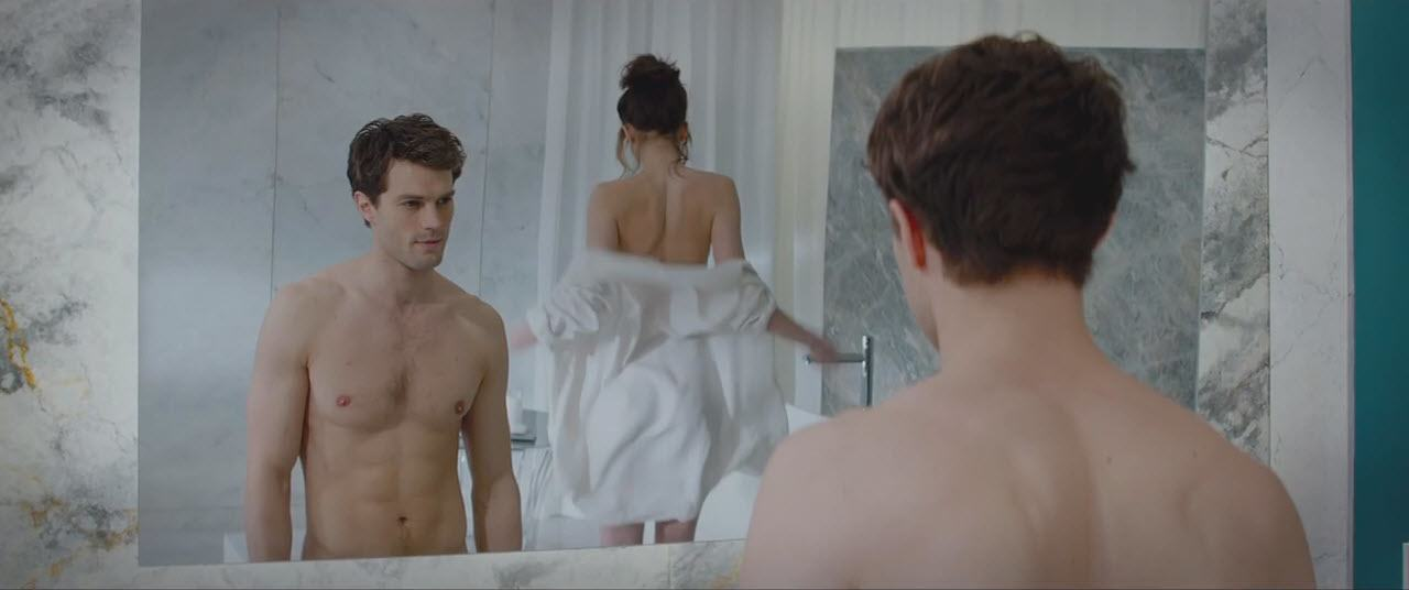 jamie dornan shirtess with dakota johnson in fifty shades of grey movie 2015