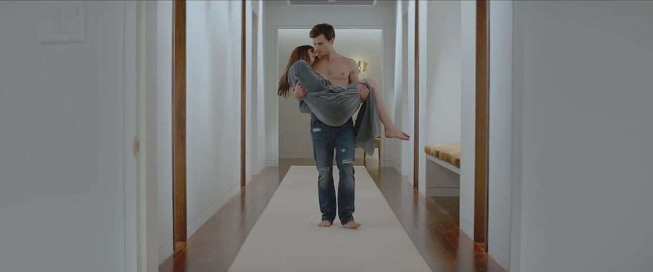 jamie dornan shirtless carrying dakota johnson in fifty shades of grey 2015