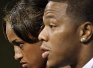 janay rice standing by husband ray images