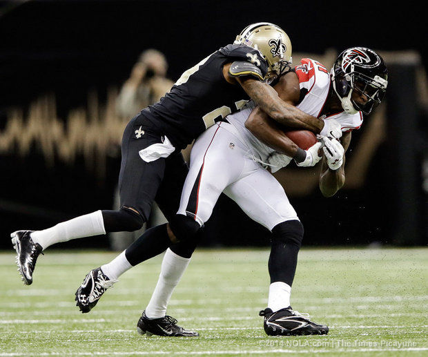 julio jones falcons jumping on keenan lewis new orleans saints nfl 2014 images