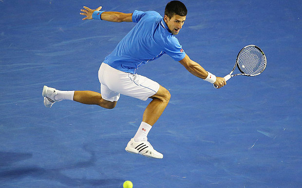 novak djokovic jumps for stan wwawrinka balls at australian open 2015