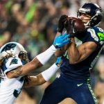 russell wilson panthers fighting doug baldwin seahawks for ball nfl divisions 2015