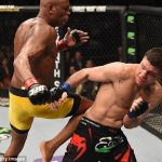 anderson silva putting knee to nick diaz back for ufc 183 2015 images