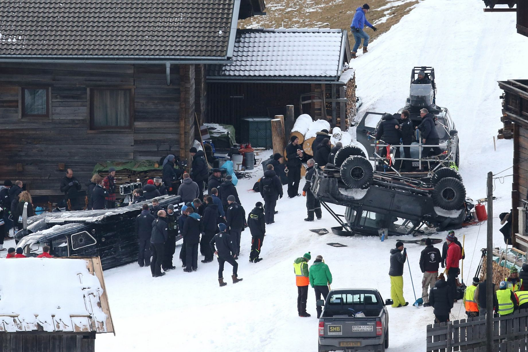 daniel craig running to overturned car in spectre movie