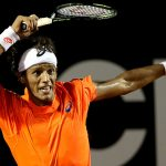 joao souza returns tennis serve to haider maurer rio open 2015