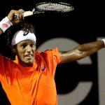 joao souza returns tennis serve to haider maurer rio open 2015