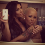 kim kardashian hugging amber rose from kanye west 2015
