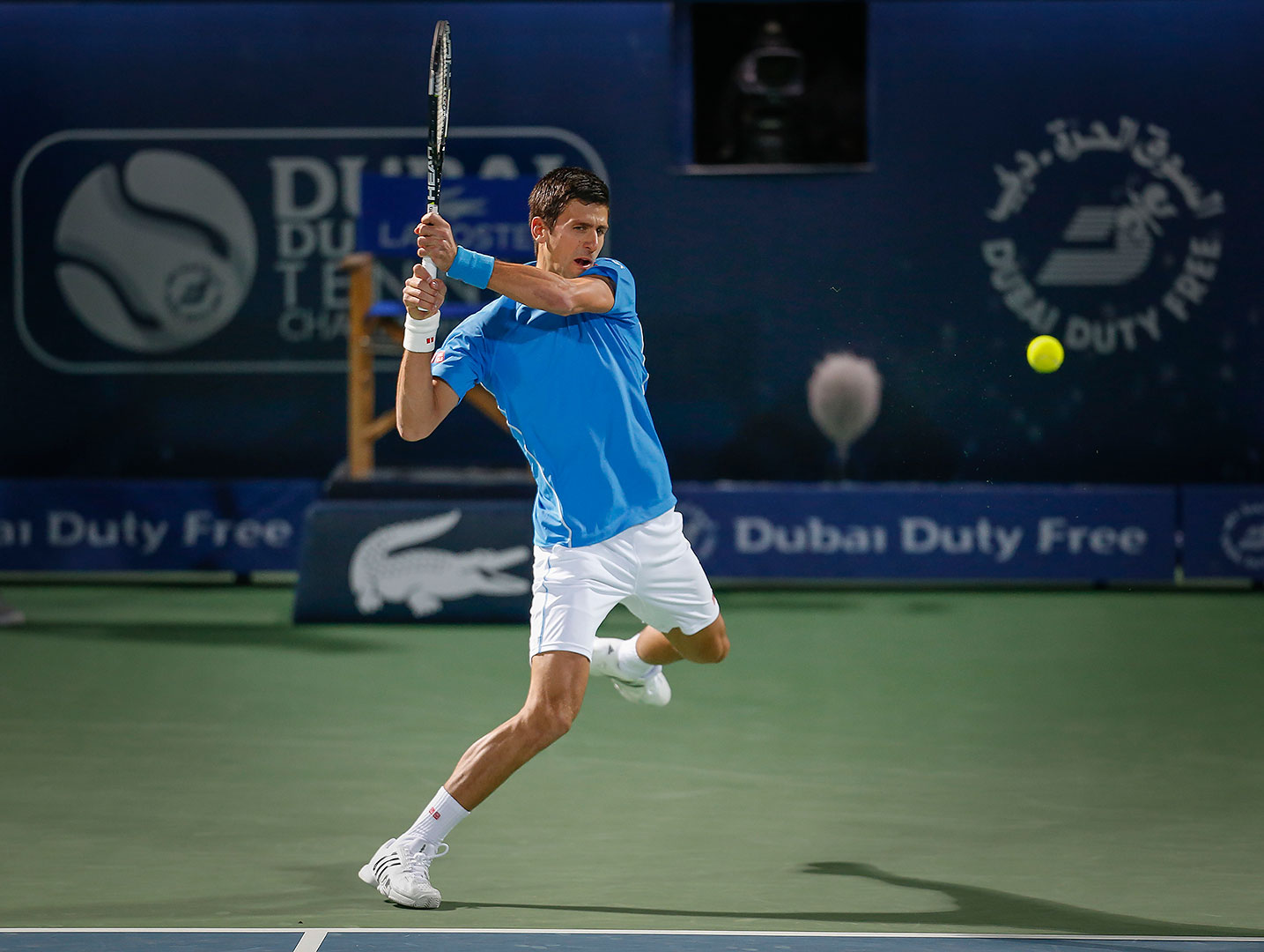 novak djokovic takes out borna coric atp dubai tennis 2015 images