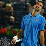 novak djokovic worn down by roger federer dubai 2015 iamges