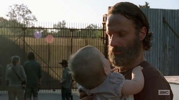 rick with baby outside alexandria community walking dead ep 11