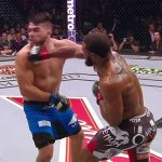 tyron woodly right hook on kelvin gastelum ufc 183 fight images 2015