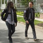 michonne with rick in police drag on the walking dead 2015