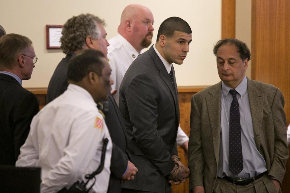aaron hernandez smiling with attorney for guilty verdict 2015