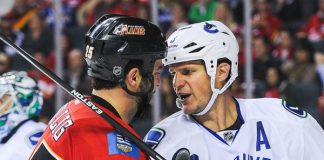 Vancouver Canucks vs Calgary Flames men fight hockey 2015