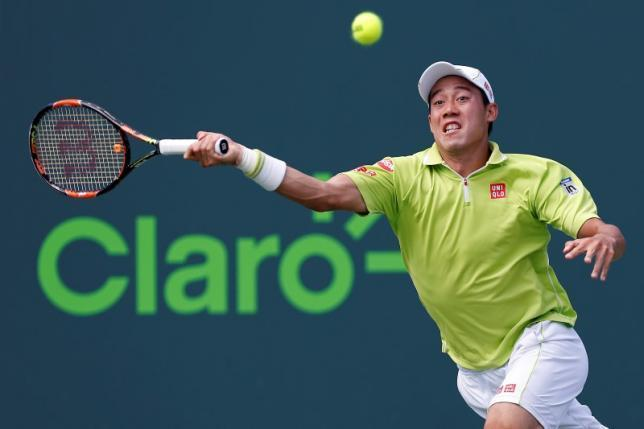 kei nishikori holds on to barcelona title 2015