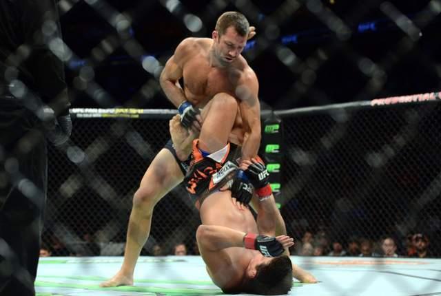 luke rockhold turns lyoto machida upside down for ufc fight night 2015