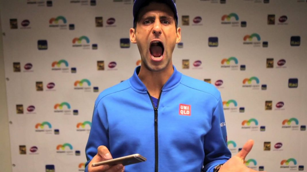 novak djokovic opening mouth up for mans tennis ball 2015