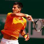 novak djokovic returns ball to andreas haider maurer for monte carlo masters win 2015