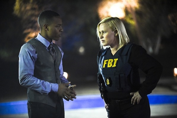 patricia arquette with black boy on csi cyber fire code 2015