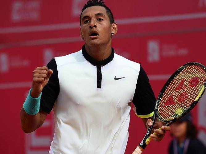 nick kyrgios beats roger federer madrid open 2015