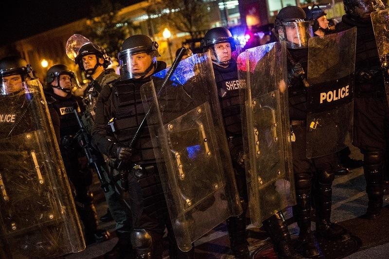 police smiling arresting protestor 2015